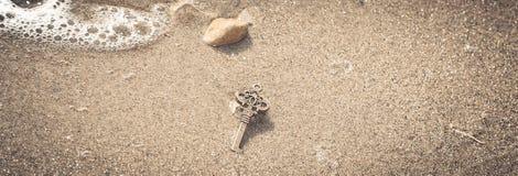 Key to the lake sand Royalty Free Stock Photos