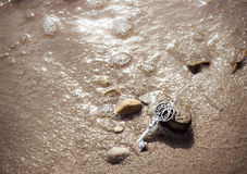 Key to the lake sand Royalty Free Stock Photography