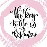 The key to life is happiness hand written lettering positive   Royalty Free Stock Images