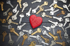 Key Love Heart Search Romance. A conceptual image with a heart and keys on a wood background Royalty Free Stock Photo