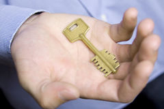 Key to the man's palm Royalty Free Stock Photo
