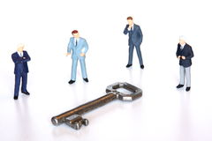 Key to the market. Businessmen gathered around the key to the market Stock Images