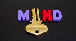 Key to the mind. Text  mind  in colorful uppercase letters with the letter Royalty Free Stock Images