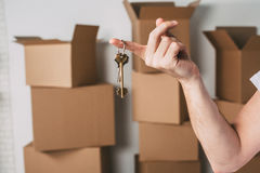 Key to a new apartment or hause on boxes background. Stock Image