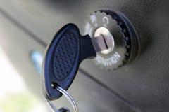 Key to open the lock closed macro Stock Image