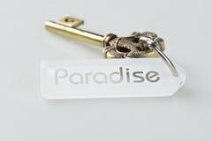 Key to Paradise. Gold, ornate key with tag word Paradise Stock Image