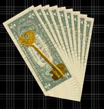 Key to a prosperity. Money to a dark background and an old metal key Royalty Free Stock Images