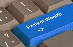 Key to protect wealth. Keyboard with key to protect wealth Royalty Free Stock Photos