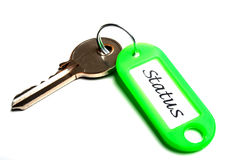 Key to Status. Concept photo showing a key with a key holder displaying the word status Stock Photos