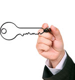 Key to succes. Busimessman drawing key to succes Royalty Free Stock Image