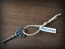 The key to succes. Key on the table with a note written on it success; Key to succes Royalty Free Stock Photos