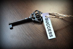 The key to succes. Key on the table with a note written on it success; Key to succes Royalty Free Stock Images