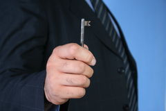KEY TO SUCCESS. Businessman offering key Royalty Free Stock Images