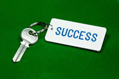 Key to Success. Key and key fob labelled success on a green background Stock Photos