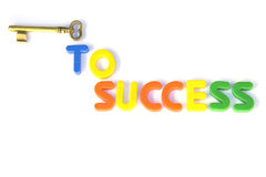Key to success. Colored text with the word success and a gold key Royalty Free Stock Photos