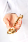 Key to success. Hand is giving a gold key. Success concept Stock Photo