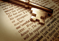Key to success. Closeup of a gold key and dictionary entry for the word success Royalty Free Stock Image