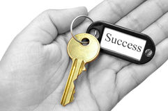 Key to success. Key ring with the word 'success' attached to a gold key in a hand Royalty Free Stock Photo