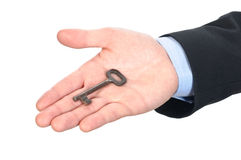 Key to success. Young man who delivers the key office or home royalty free stock images