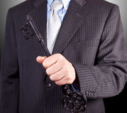 The Key To Success. Businessman holding key to success Stock Photography