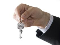 Key to success. Hand holding the key to success Royalty Free Stock Images