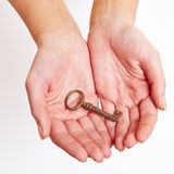 The key to success. Laying on the hand Royalty Free Stock Images