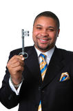The Key To Success. Young African American businessman holding key to success Royalty Free Stock Photos