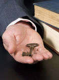 Key to success. A businessman hand off the key to success. Education Royalty Free Stock Image
