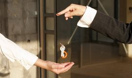 The key to success. Businesswoman passing the key to success Royalty Free Stock Photo
