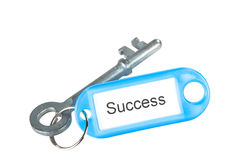 Key to success. A key with a success label isolated on white royalty free stock images
