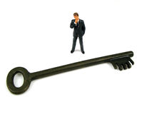 Key to success. Manager staring at the key to success stock image