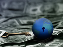 Key to success. Earth, Key and cash Royalty Free Stock Image