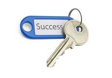 Key to success. The blue keyring key to success on white background Stock Image