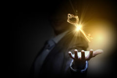 Key to success. Close up of businesswoman holding golden key in hand Royalty Free Stock Photos