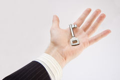 Key to success conceptual image. The businessman holds the key to success Royalty Free Stock Photo