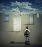 Key to success. Conceptual image with a person standing in front of different closed doors, dropping a key shadow, choosing which one to open Royalty Free Stock Photo