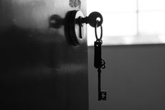 Key to success. The door is unlock by a key Stock Image