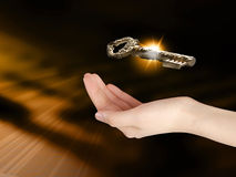The key to success. Human hand holding golden key to success Stock Photos