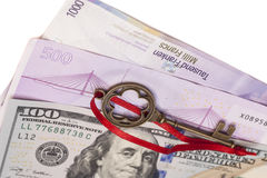 Key To Success With Red Bow on American dollars, European euro,S Royalty Free Stock Images