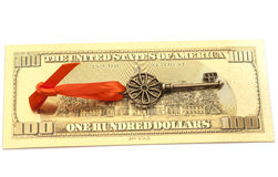 Key To Success With Red Bow on Golden hundred dollar bill Royalty Free Stock Images