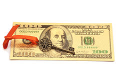 Key To Success With Red Bow on Golden hundred dollar bill Stock Images