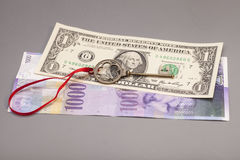 Key To Success With Red Bow on One American dollars and 1000 Swi Stock Photo