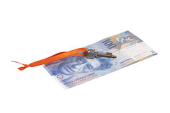 Key To Success With Red Bow on Swiss Franc note Royalty Free Stock Image