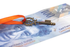 Key To Success With Red Bow on Swiss Franc note Royalty Free Stock Images