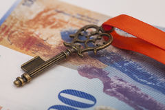 Key To Success With Red Bow on Swiss Franc note Stock Photography