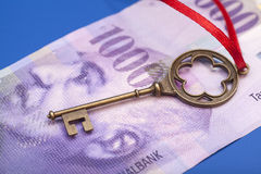 Key To Success With Red Bow on Swiss 1000 Franc note Stock Image