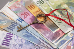 Key To Success With Red Bow on Swiss Franc notes Royalty Free Stock Photo