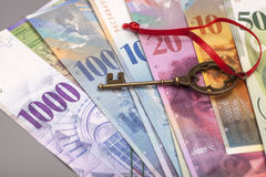 Key To Success With Red Bow on Swiss Franc notes Stock Photography