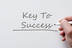 Key to success written on whiteboard Stock Image