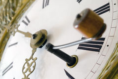 Key to Time. Close up of a key inserted into the lock of a grandfather clock Stock Photography
